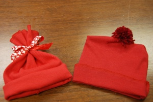 Two small red hats show the craft work of Erlanger cardiac rehabilitation nurses, Dee Clark and Debbie Croft.