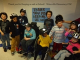 Children from the Comprehensive Development Class at Waterville Elementary in Cleveland, Tenn. testing their bicycle helmets which were donated by Children's Hospital so they will have extra protection during a tornado warning.  Pictured (from left to right) Noah Bishop, Jason Rahal, Chandler Gates, Andy Gutherie, Javonte Lazenby, Tyler Ruback, Luke Cook, Britney Wall, and Kaleigh Bass.