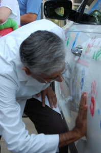 Dr. Bhakta during handprint ceremony.