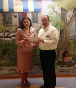 Publix district manager, Roger Hinckley, stopped by Children's Hospital to present the check to Rebecca Brinkley, CMN Hospitals representative for Children's Hospital, and take a tour of the hospital facilities and programs.
