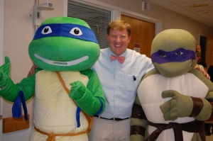 Dr. Avery Mixon, Children's Hospital oncology specialists could not resist getting a picture with Teenage Mutant Ninja Turtles, Leonardo and Donatello.