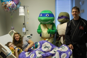 Hannah Crisp is pictured with her aunt April McGill; Teenage Mutant Ninja Turtles Leonardo and Donatello, and Ed Rose from Fort Oglethorpe Tiger Rock Martial Arts.